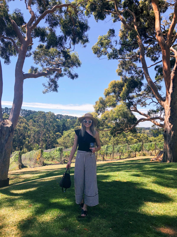 Jessica Sturdy wearing striped wide leg pants for wine tasting on the Mornington Peninsula near Melbourne Australia