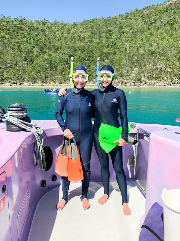 Hallie Wilson and Jessica Sturdy wearing snorkeling gear on a boat in the Great Barrier Reef in Australia