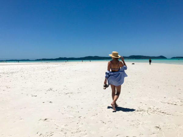 Jessica Sturdy wearing a striped shirt on Whitehaven Beach in the Whitsundays in Australia