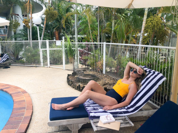 Jessica Sturdy wearing a Summersalt one piece yellow and navy blue one piece swimsuit at The Lord Byron Hotel in Byron Bay Australia
