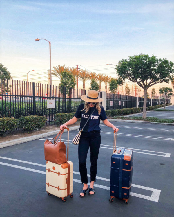 Jessica Sturdy wearing a Cynthia Rowley Cali York tee with Bric's Bellagio suitcases in Los Angeles