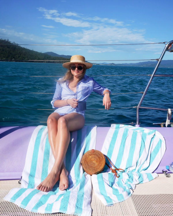 Jessica Sturdy wearing a Vineyard Vines striped button-front shirt on a boat tour of the Whitsundays Islands and the Great Barrier Reef in Australia