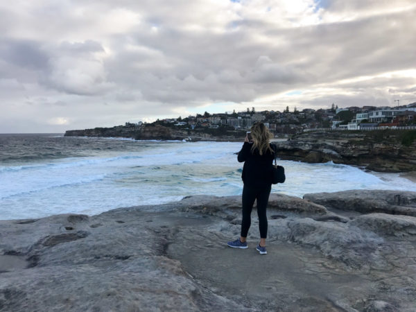 Jessica Sturdy wearing APL Sneakers on the Bondi to Coogee Beach Walk in Sydney Australia