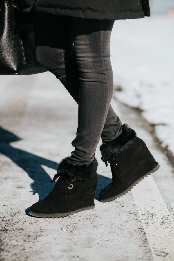 Jessica Sturdy wearing fur-trimmed booties with black denim for winter in Chicago.