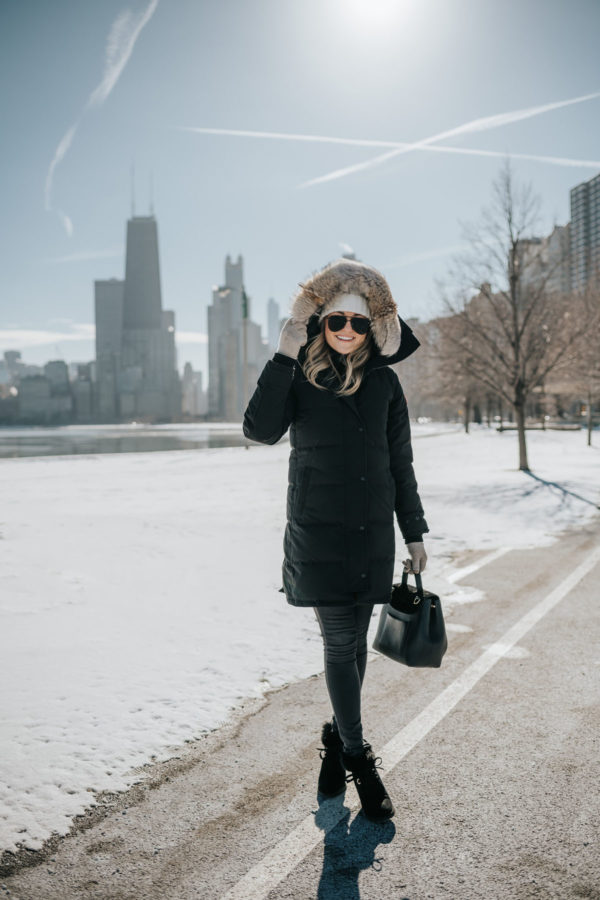 Jessica Sturdy shares tips for surviving cold winters in Chicago, wearing a Canada Goose coat.