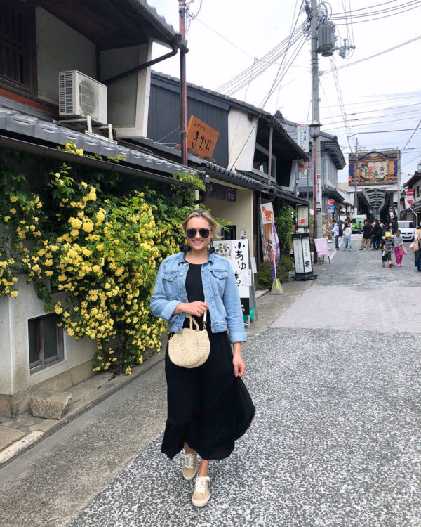 Bows & Sequins Travel Guide in Nagahama Japan. Jessica Sturdy wearing a denim jacket, Old Navy maxi dress, Seavees raffia sneakers, BaubleBar black tassel earrings, and a Clare V mini straw bag.