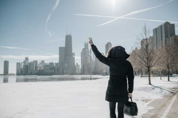 Chicago lifestyle blogger Jessica Sturdy wearing a Canada Goose jacket with a Polene top handle bag.