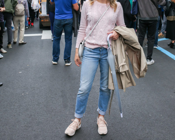 Fashion and travel blogger wearing a pink J.Crew sweater with Vineyard Vines boyfriend jeans and blush sneakers at Tsukiji Fish Market in Tokyo, Japan.