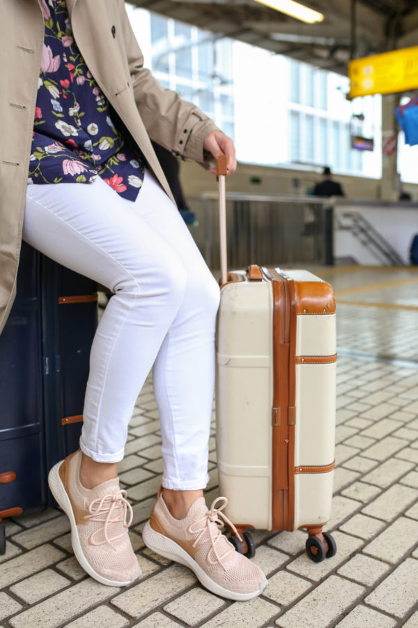 Jessica Sturdy styling blush pink sneakers with white jeans.