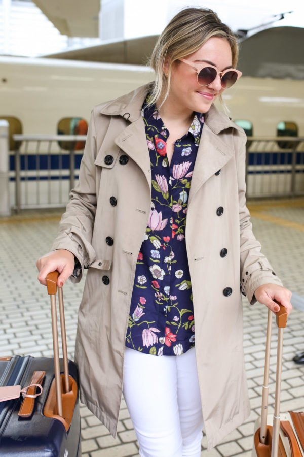 Jessica Sturdy styling a Rebecca Taylor floral print blouse with white jeans and a trench.