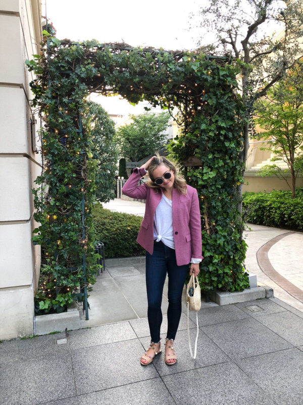 Bows & Sequins Travel Guide in Tokyo Japan. Jessica Sturdy wearing a pink J.Crew blazer, a white tee, Frame denim, and Loeffler Randal sandals in Omotesando.