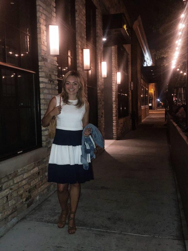 Jessica Sturdy at Ella Elli in Chicao wearing a striped dress.