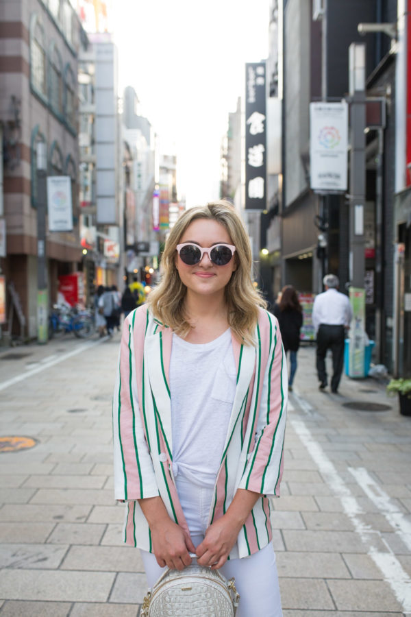 Fashion blogger Jessica Sturdy wearing an oversized striped blazer with a white tee in Osaka, Japan.