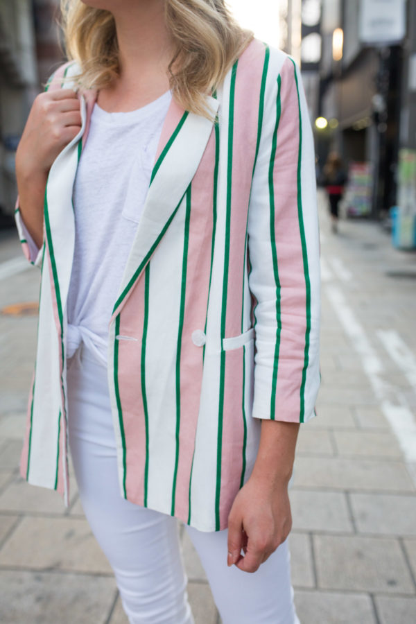 Jessica Sturdy styling a pink, white, and green oversized striped blazer in Japan.