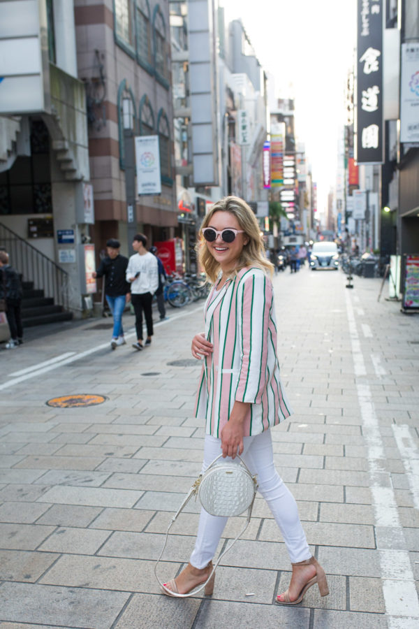 Travel blogger Jessica Sturdy wearing an all white outfit in Japan.