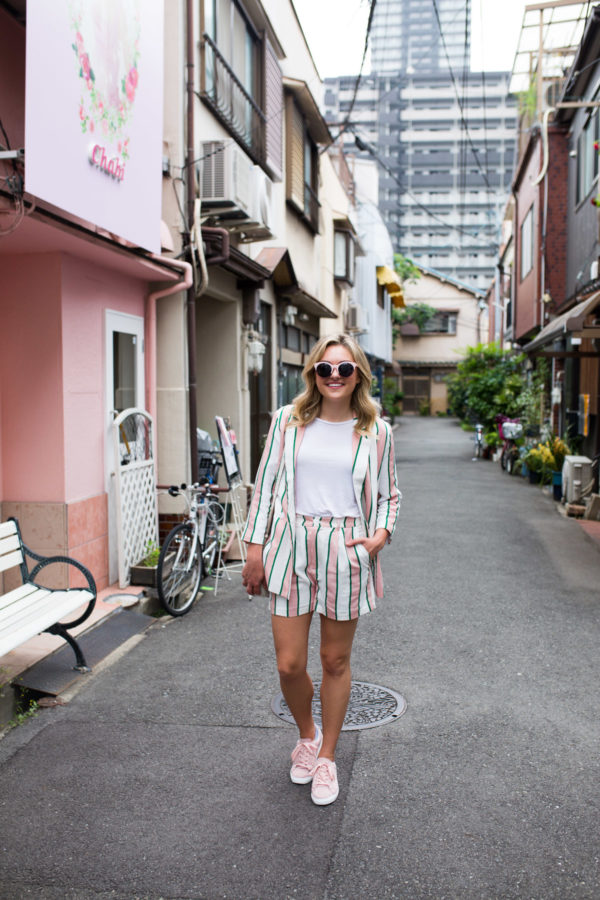 Jessica Sturdy wearing a matching blazer and shorts with sneakers in Japan.