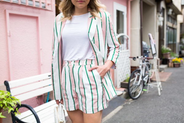 Jessica Sturdy wearing a matching pink and white blazer and short suit set in Japan.