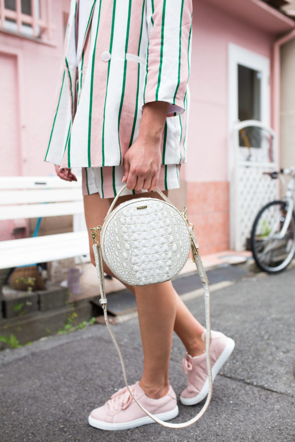Fashion blogger Jessica Sturdy wearing a Brahmin Lane Melbourne round top-handle bag in Japan.