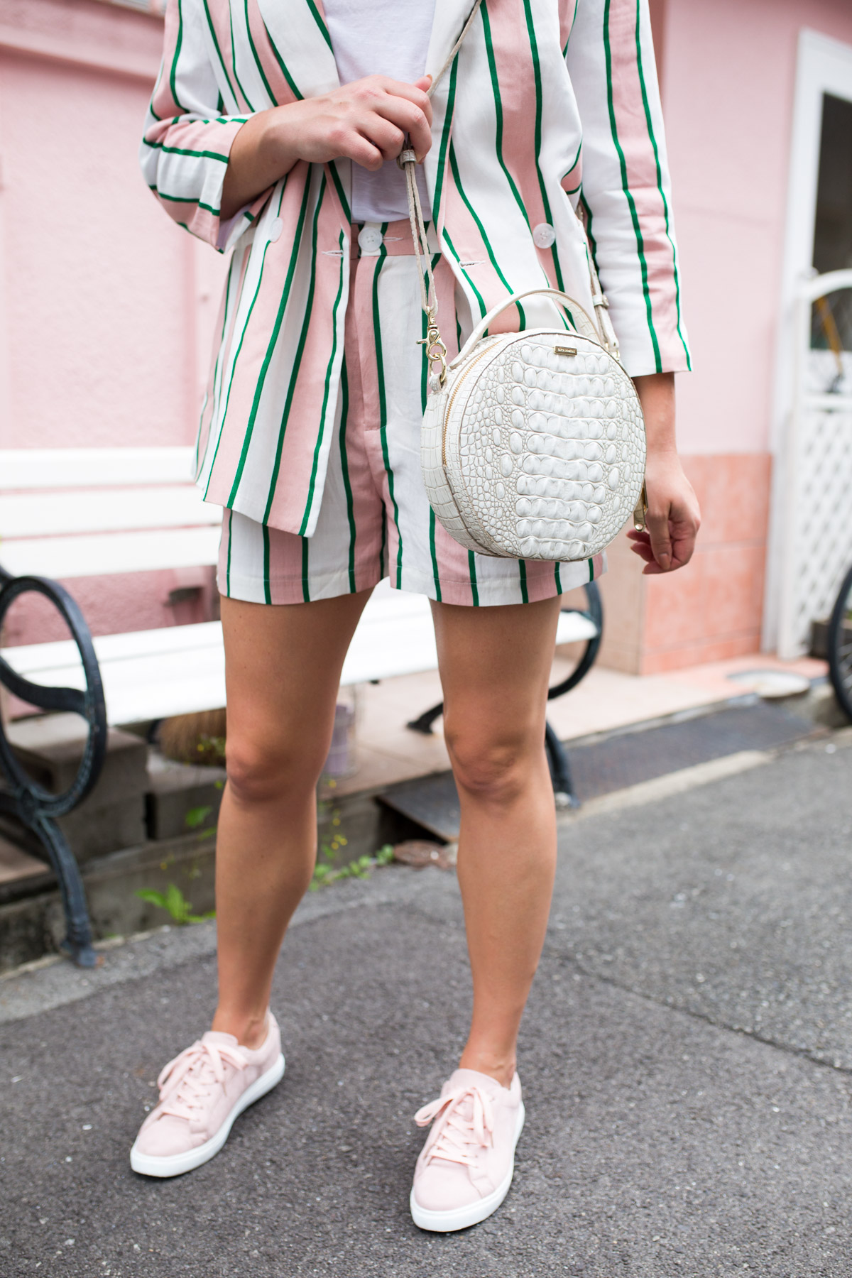 Fashion blogger Jessica Sturdy wearing the new white embossed round Brahmin Lane Melbourne bag with a matching blazer and shorts in Japan.