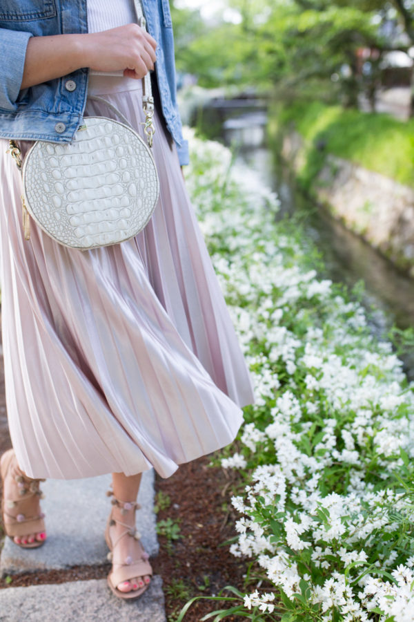 Jessica Sturdy styling a Rachel Roy pleated lavender midi skirt along the Philosopher's Path in Kyoto, Japan.