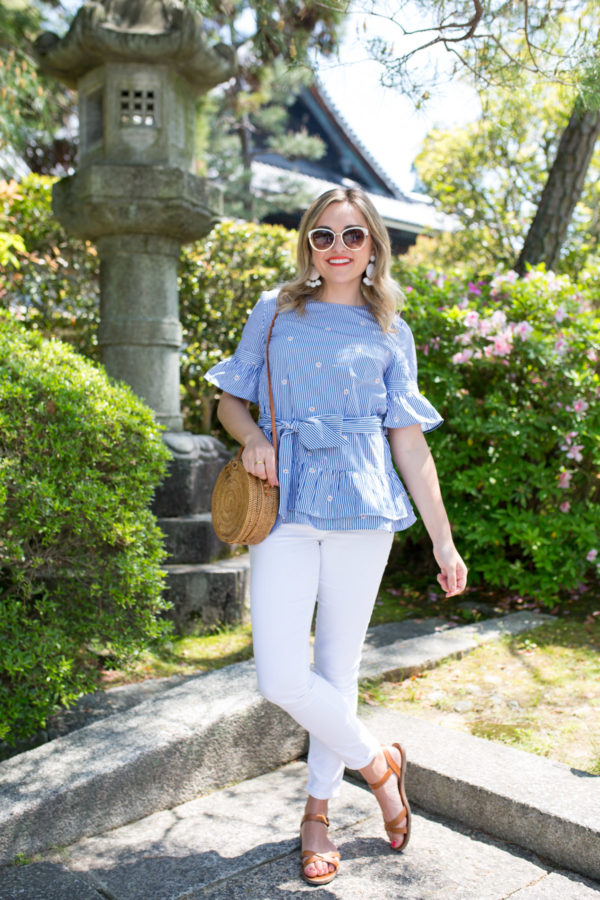 Jessica Sturdy wearing a blue and white peplum top in Kyoto Japan.