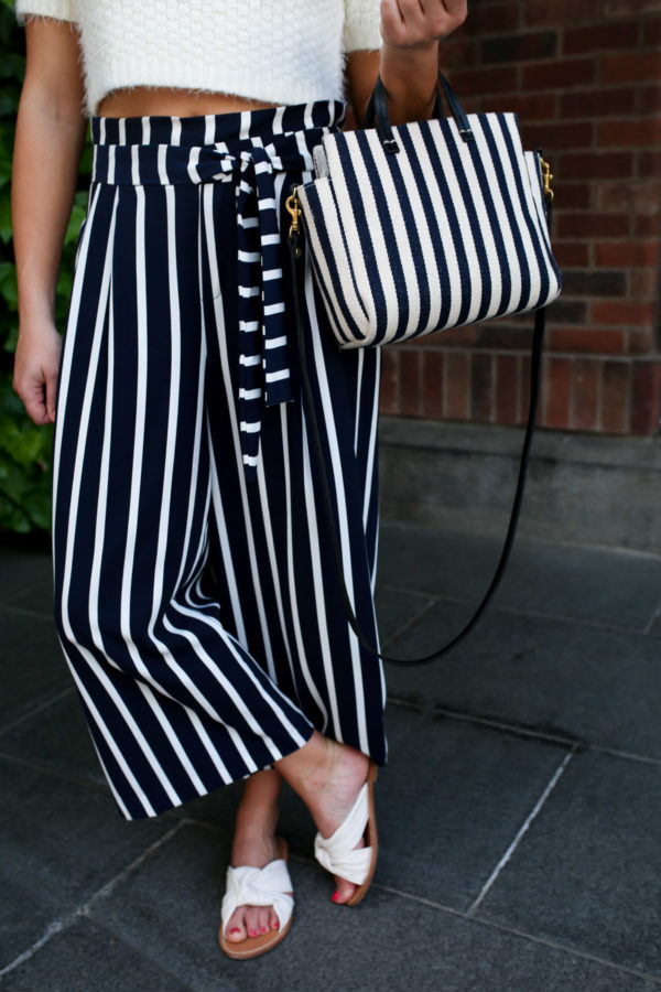 Jessica Sturdy wearing a pair of high-waisted wide leg striped pants from Zara.
