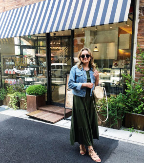 Jessica Sturdy in Kobe, Japan wearing an Old Navy maxi dress, denim jacket, Loeffler Randall pom pom sandals, Illesteva sunglasses, and a Clare V Straw tote
