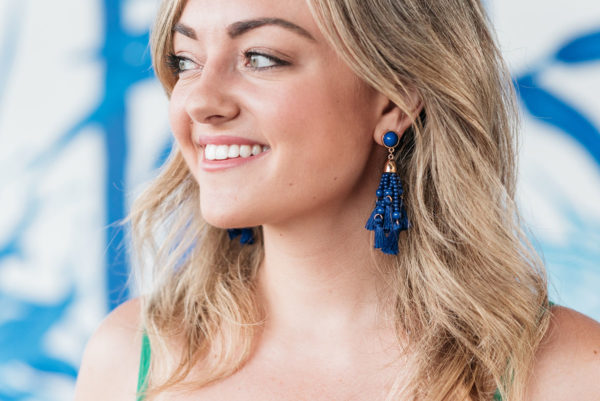 Jessica Sturdy wearing blue tassel earrings from BaubleBar.