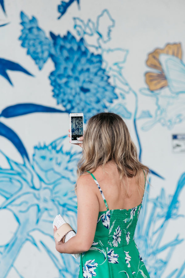 Bows & Sequins taking an Instagram photo of the chinoiserie mural in Ping Tom Park in Chicago.