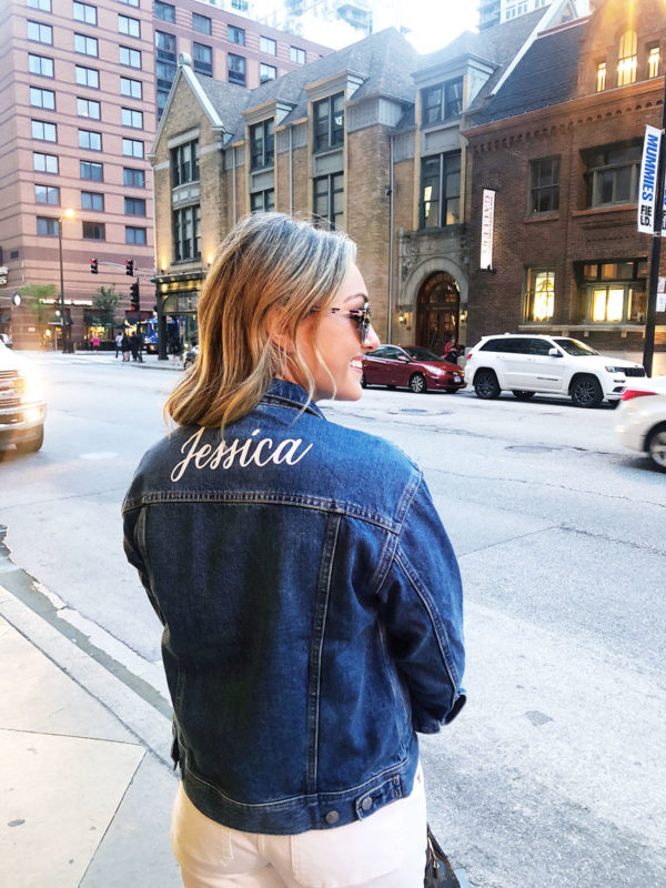 Jessica Sturdy wearing a custom denim jacket from Everlane with white jeans.