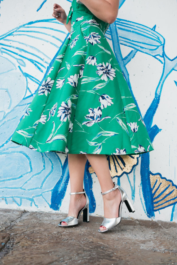 Top Chicago blogger Jessica Sturdy wearing a green floral dress with silver pumps.