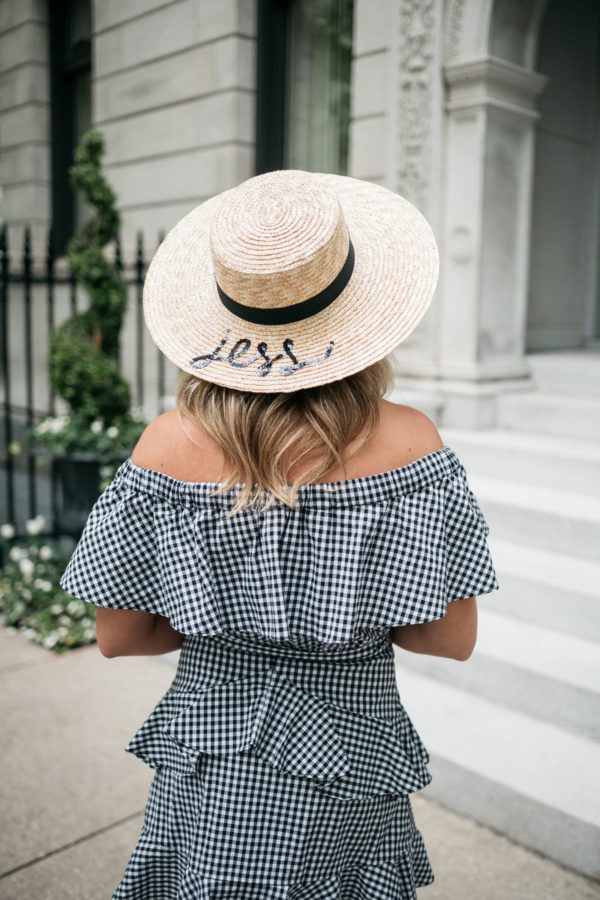 Fashion blogger Jessica Sturdy wearing a monogrammed White Elephant Designs hat and a black and white gingham off the shoulder ruffled dress.