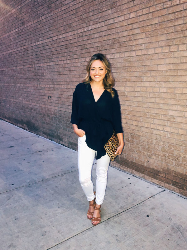 Chicago blogger Jessica Sturdy styling a navy blouse, white jeans, tan lace-up sandals, and a Clare V leopard clutch for a night out in the West Loop.