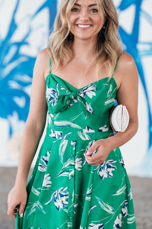 Jessica Sturdy, fashion and beauty blogger based in Chicago, wearing a green floral fit and flare midi dress.