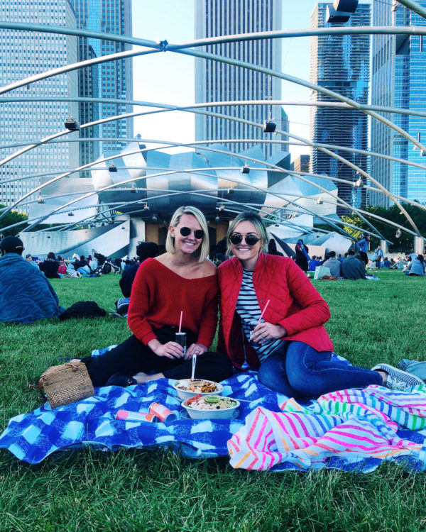 Chicago lifestyle blogger Jessica Sturdy wearing a red Barbour jacket at Millennium Park Summer Film Series Movie in the Park with gingham and striped picnic blankets.