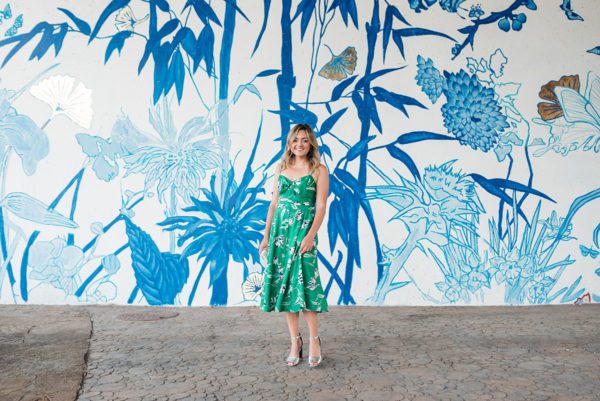 Chicago lifestyle blogger Jessica Sturdy styling a green midi length dress with silver ankle-strap heels.