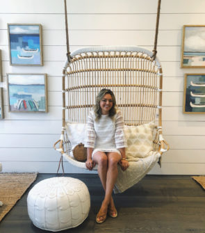 Jessica Sturdy in the swinging hanging chair at Serena & Lily Design Shop new store in Chicago on Armitage in Lincoln Park