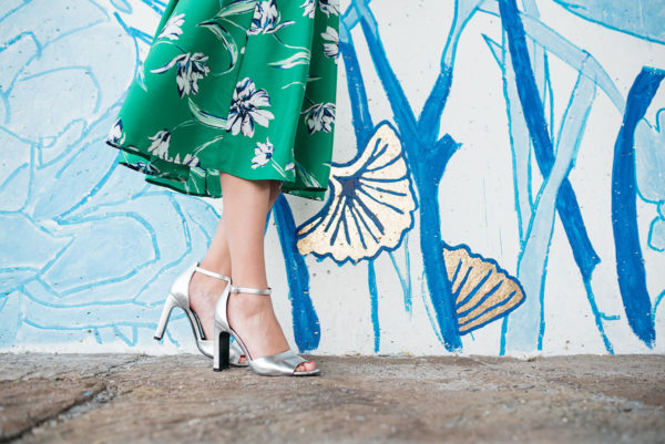 Bows & Sequins wearing a pair of Marc Fisher silver ankle-strap heels.