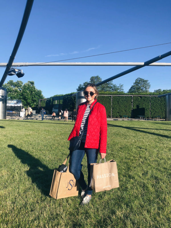 Chicago blogger Jessica Sturdy at Millennium Park for a summer movie wearing a red Barbour jacket and Frame jeans.