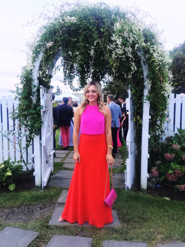 Jessica Sturdy wearing a red and pink colorblocked dress in Nantucket at Summer House at Mackenzie Horan's wedding.