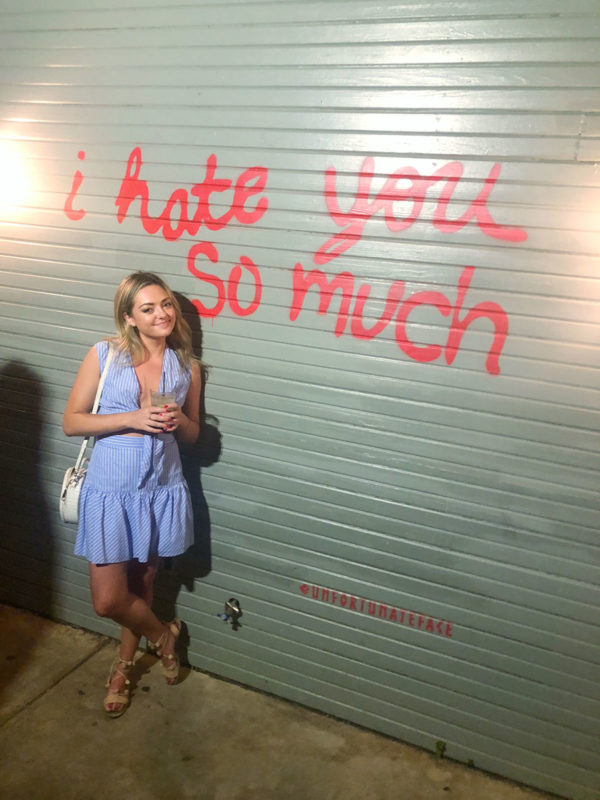 Travel blogger at bar on Rainey Street in Austin Texas