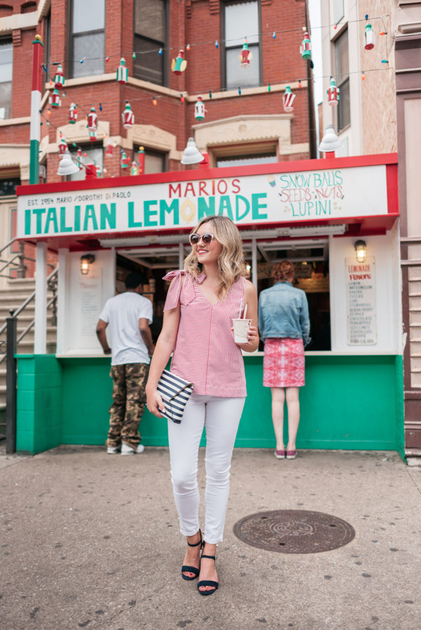 Chicago style blogger Jessica Sturdy wearing a red and white Vineyard Vines top, Old Navy white jeans, and blue sandals.