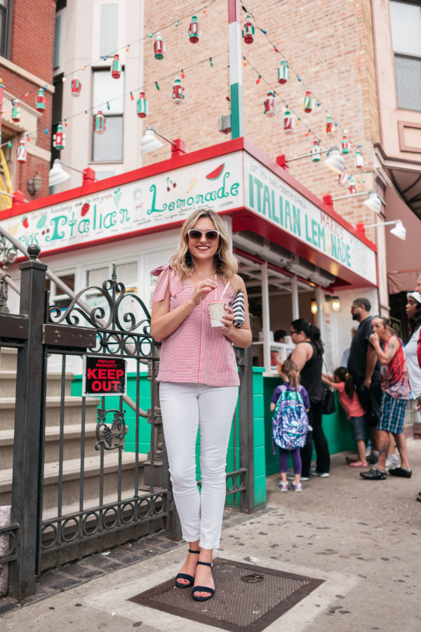 Chicago fashion blogger Jessica Sturdy wearing a patriotic outfit for the Fourth of July with a red and white striped top and white jeans.