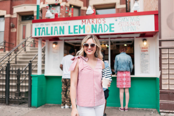 Chicago fashion blogger Jessica Sturdy wearing a Vineyard Vines red and white striped top with a big bow detail on the shoulder.