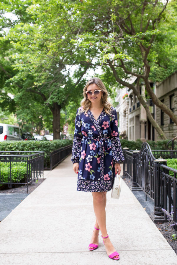 Chicago fashion blogger Bows & Sequins wearing a long sleeve floral wrap dress with pink heels.