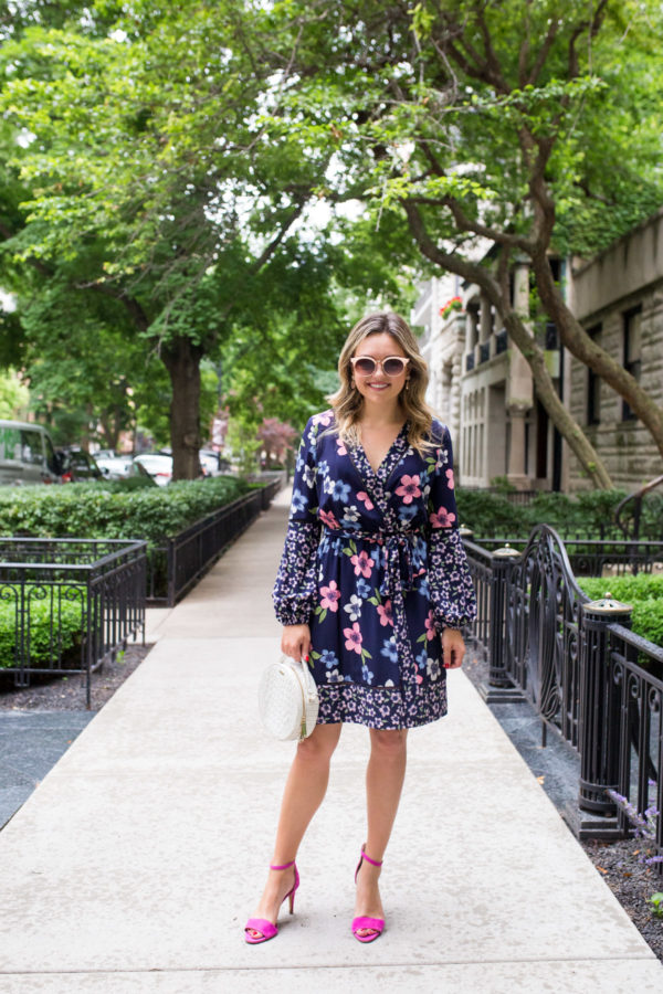 Bows & Sequins Chicago blogger wearing a floral wrap dress with a white circle bag.