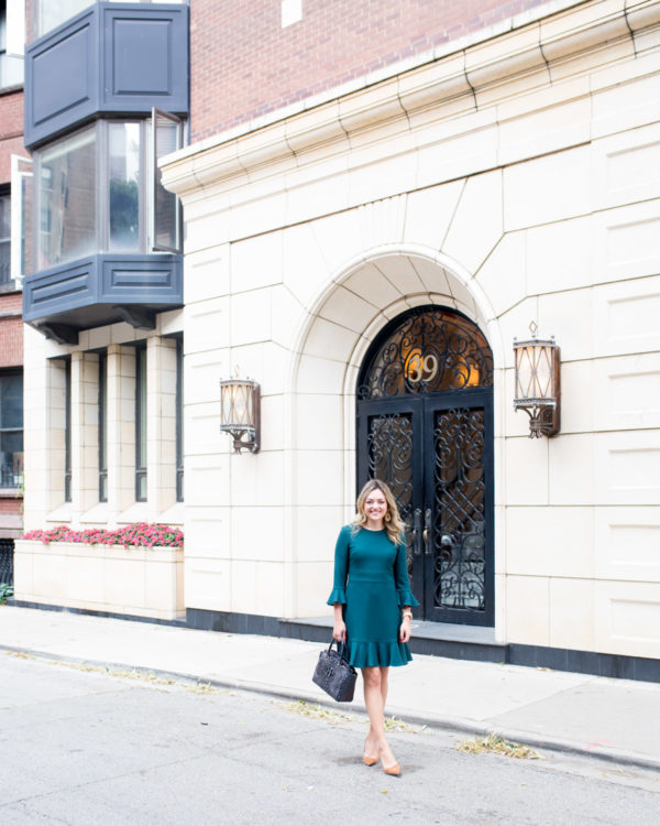 Chicago fashion blogger Jessica Sturdy wearing a ruffled hem long sleeve dress by Eliza J.