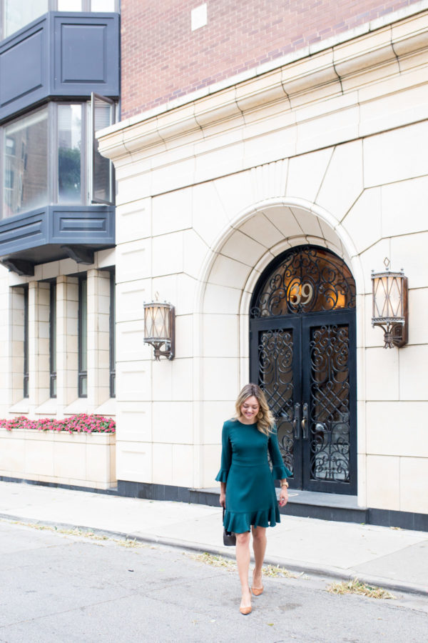 Chicago blogger Bows & Sequins styling an emerald green dress for the work week.