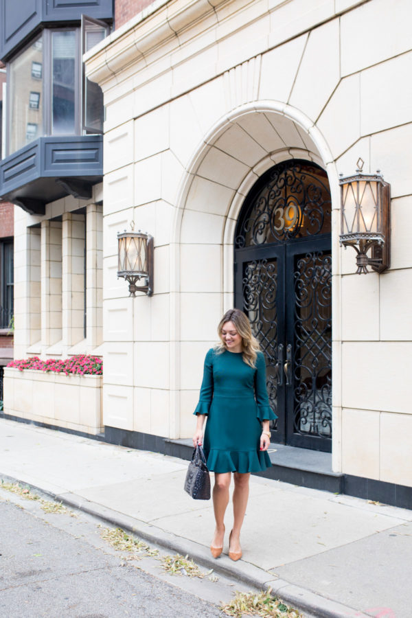 Chicago fashion blogger Bows & Sequins wearing an Eliza J dress with pumps and a cute work bag.