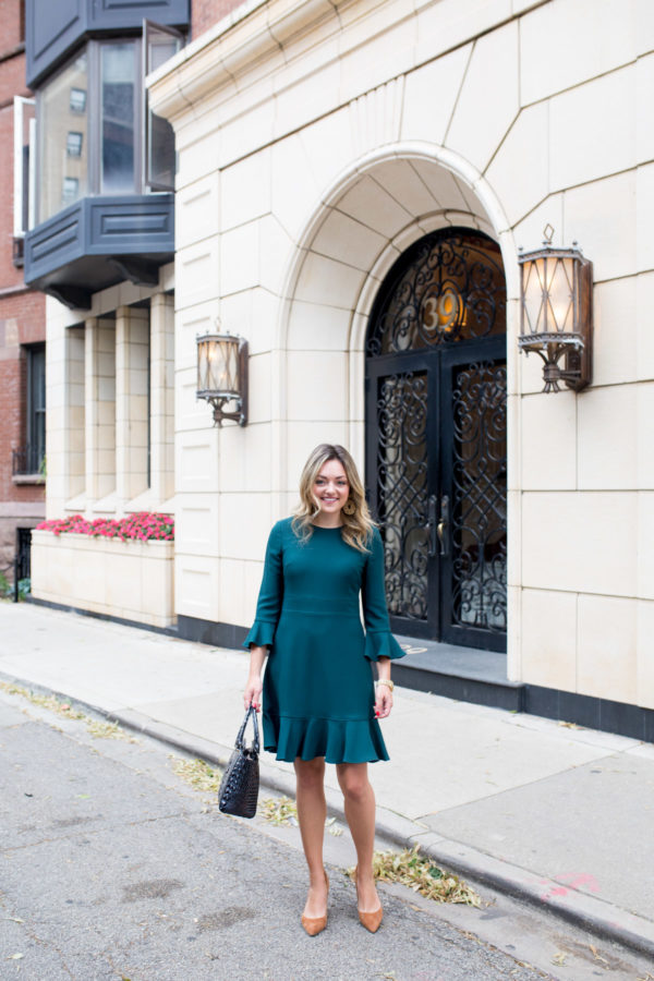 Chicago personal stylist Jessica Sturdy wearing a green ruffled dress for work.